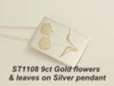 Silver pendant with 9ct gold flowers and leaves.
