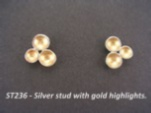 Silver studs with 3 small gold lined domes.