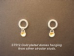 Silver circular wire studs with gold lined dome hanging off