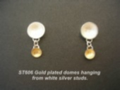Silver dome studs with gold lined dome hanging off.