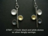 Silver dangly earrings with 3 domes, gold, black and white